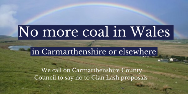 Picture of hills with a rainbow and blue sky with the words no more coal in Wales - in Carmarthenshire or elsewhere